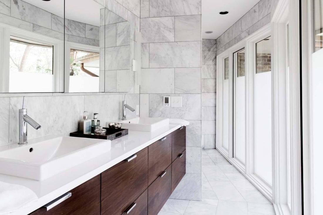 MDM Design Studio | Dark Cabinets in Marble Bathroom by MDM Design ...