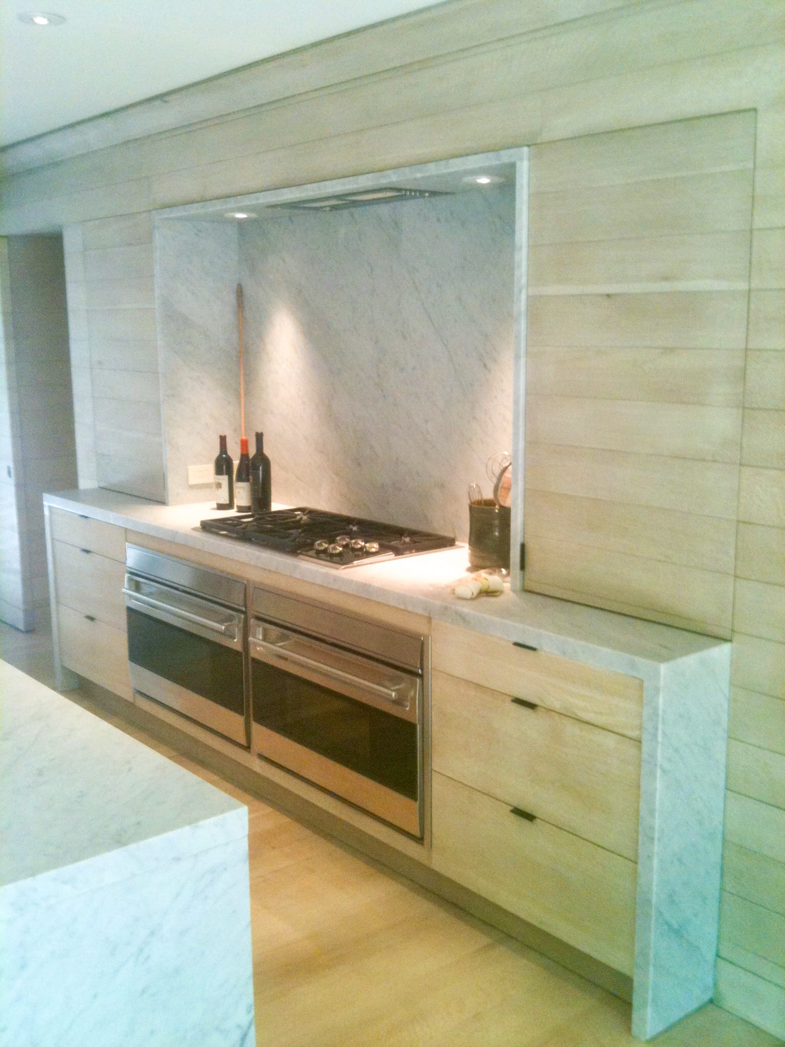 Paneled Light Wood kitchen with grey marble accents