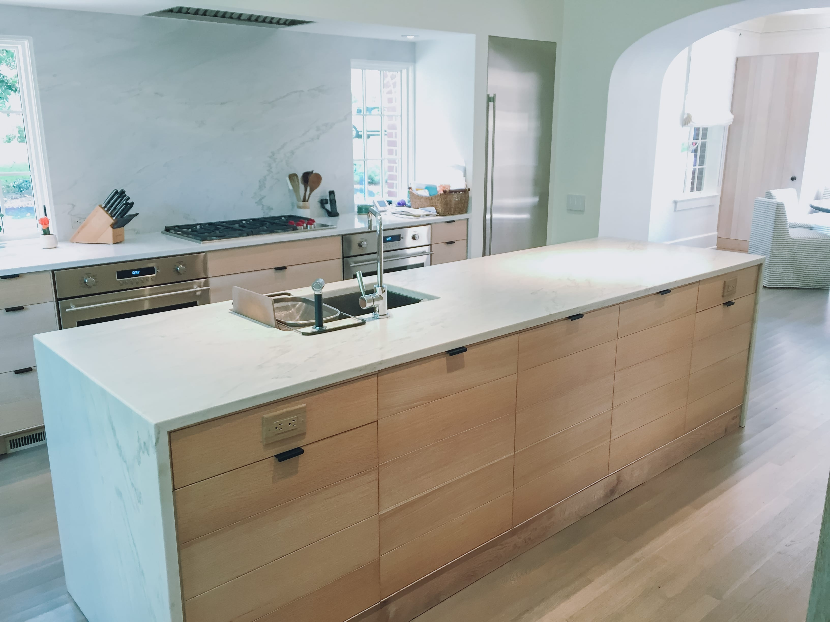Simple White Oak Kitchen Island with cabinetry