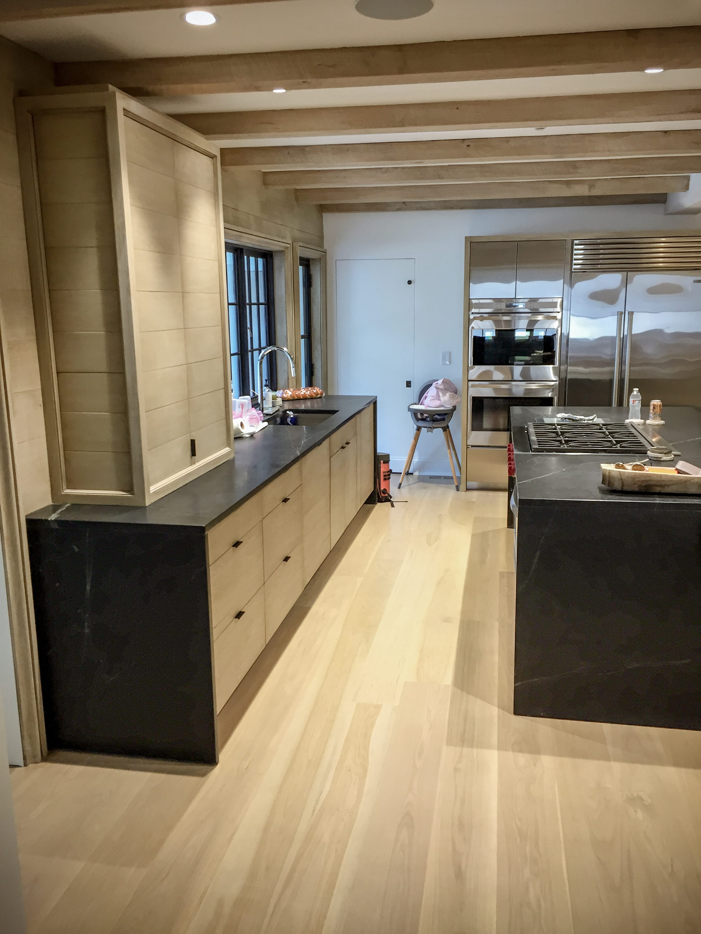 Stainless Steel Kitchen With Light Wood Cabinets