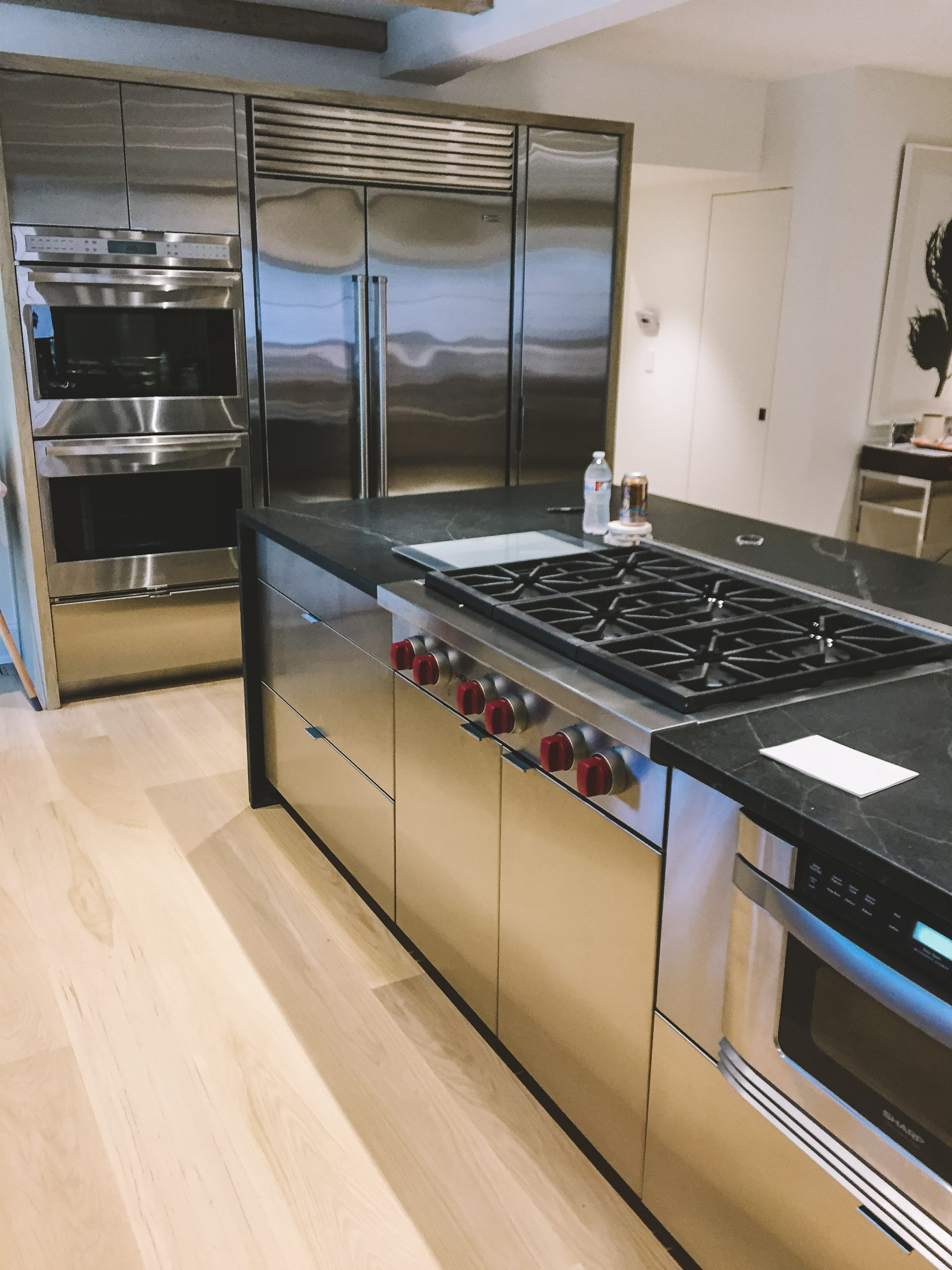 Custom stainless steel and black marble kitchen