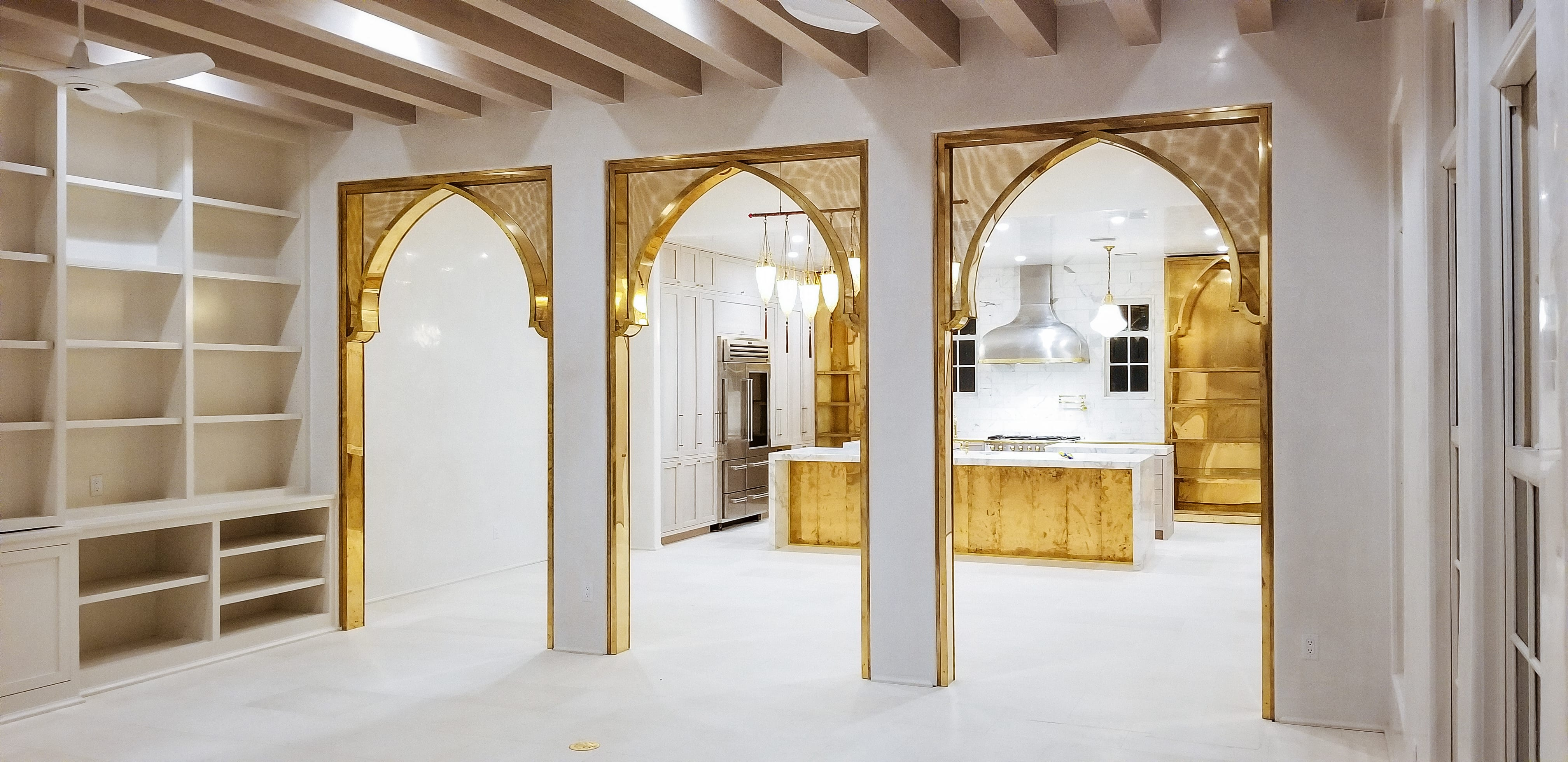 Oak and Brass Kitchen with Gold Arch Entryway