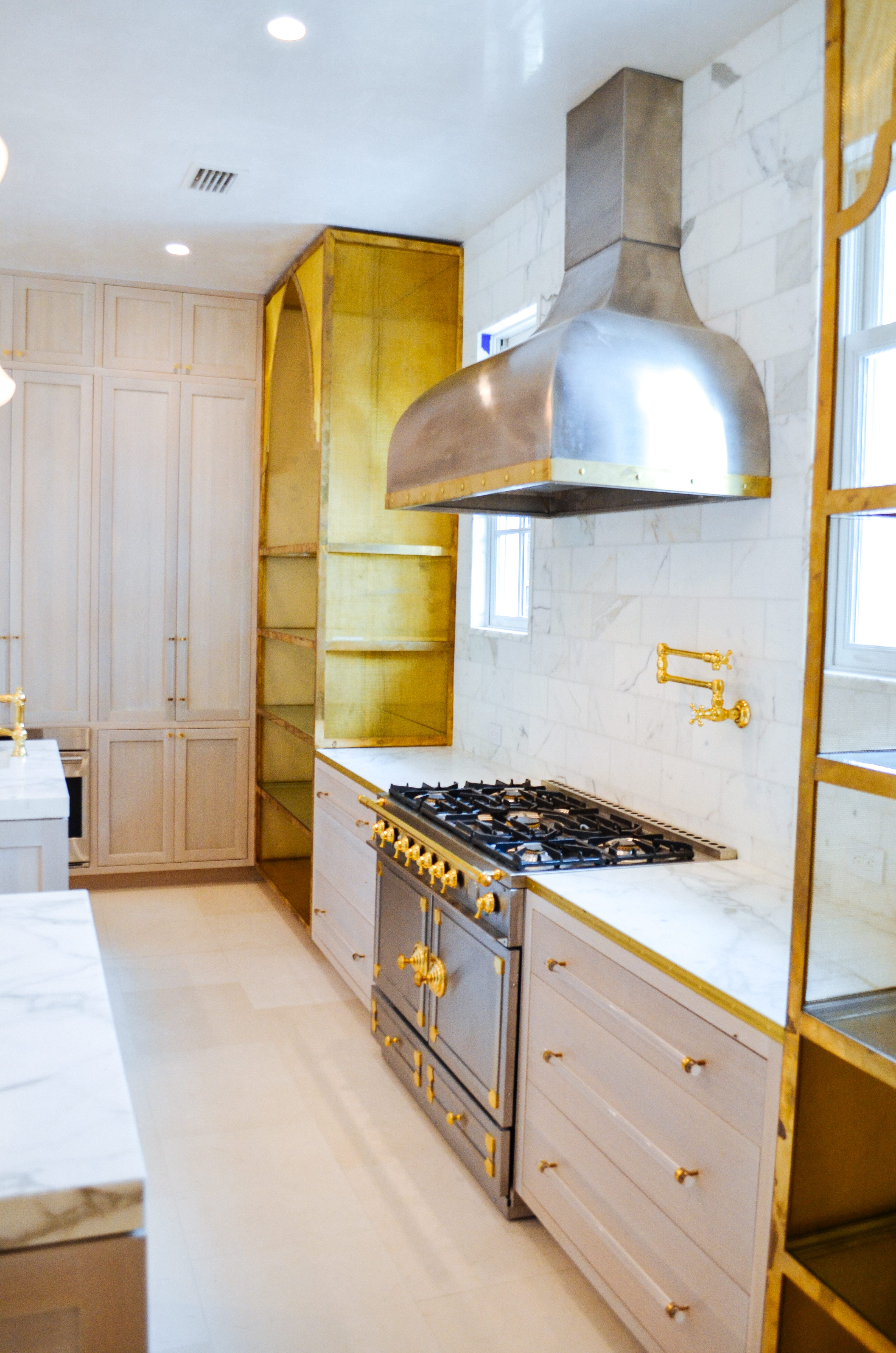 Oak and Brass Kitchen with Stainless Steel Stove