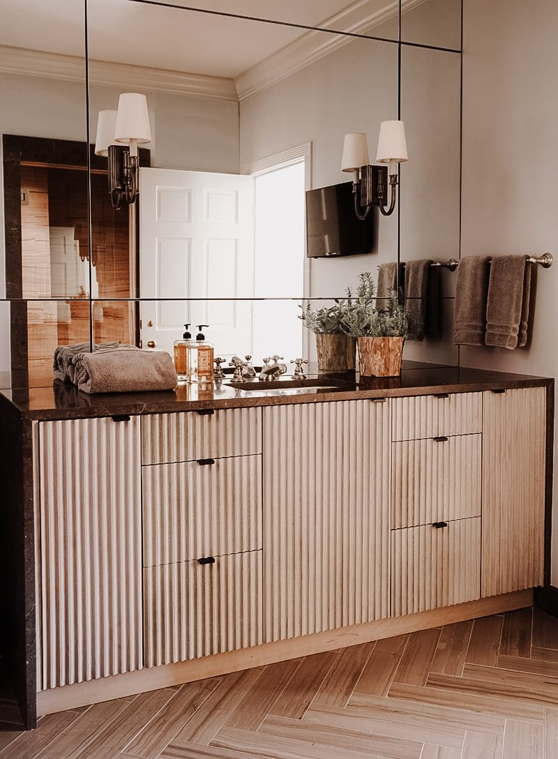 Fluted Vanity with brown marble countertop