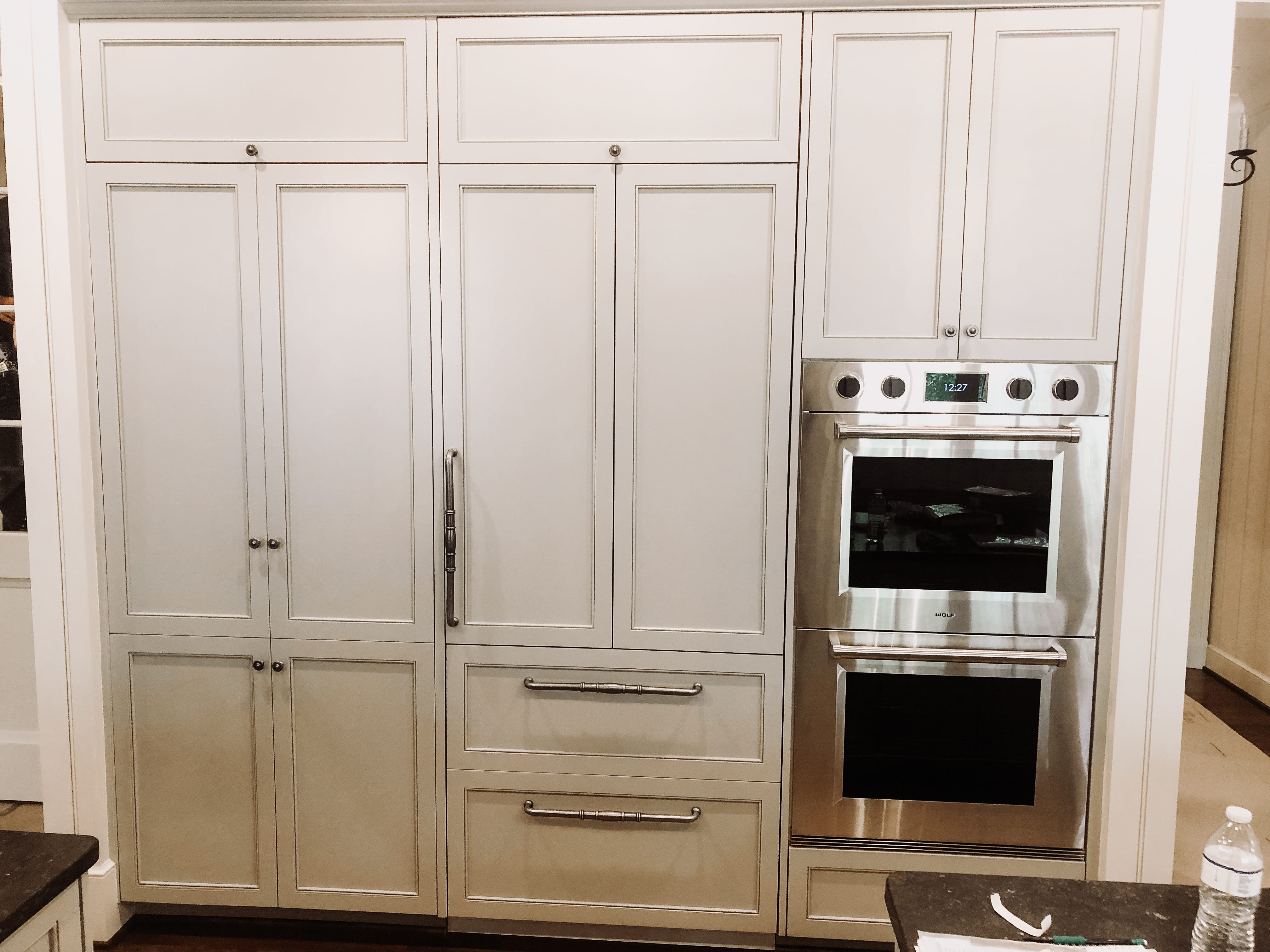 Traditional White Cabinets with Black Details and Stainless Steel Appliances