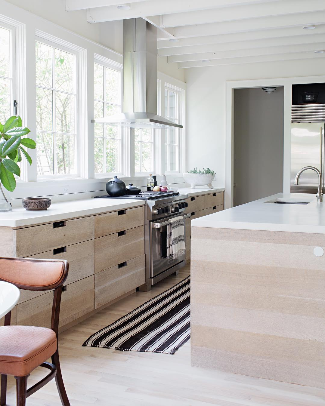 Airy White Open Kitchen with wood cabinetry