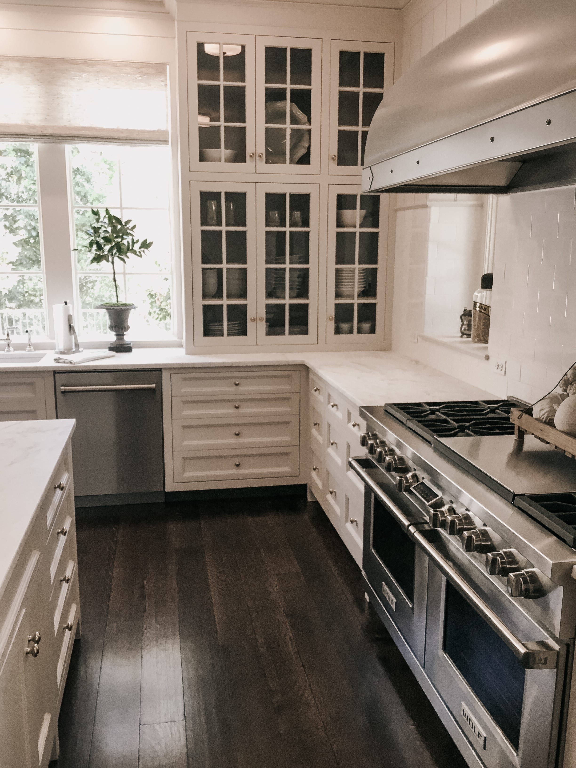 Classic White Kitchen with Glass Front Cabinets