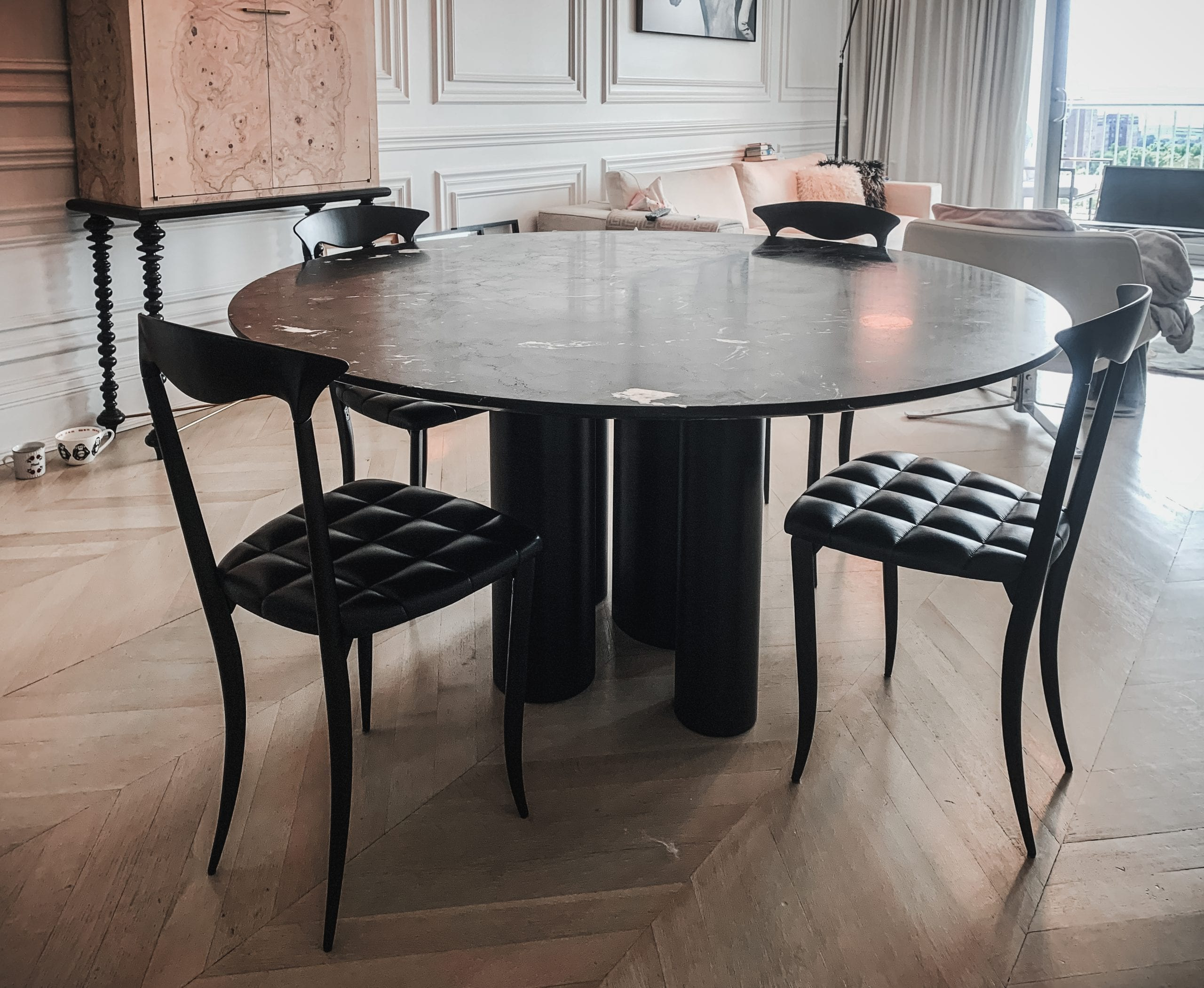 Marble and wood dining table with chairs